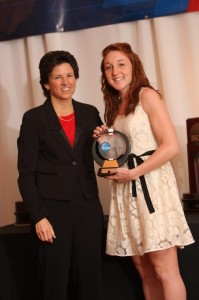 Marah Sobczak accepts the Elite 89 Award from NCAA Assistant Diector of Championships Jan Gentry at NCAA Championship banquet. Photo courtesy of Ken at HuthPhoto.com