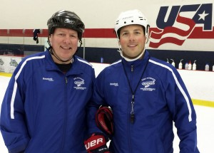 L-r: Coach Carroll with Kevin Reiter at Minnesota Hockey Goalie Camp.