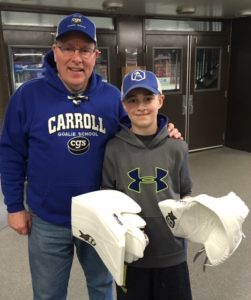 Coach Carroll presenting Otto's his new set of gloves from Brian's Custom Sports.
